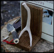 bookends_barn_wood_antler_8_tall_x_5_wide_x_5_deep_4_bordtext.jpg
