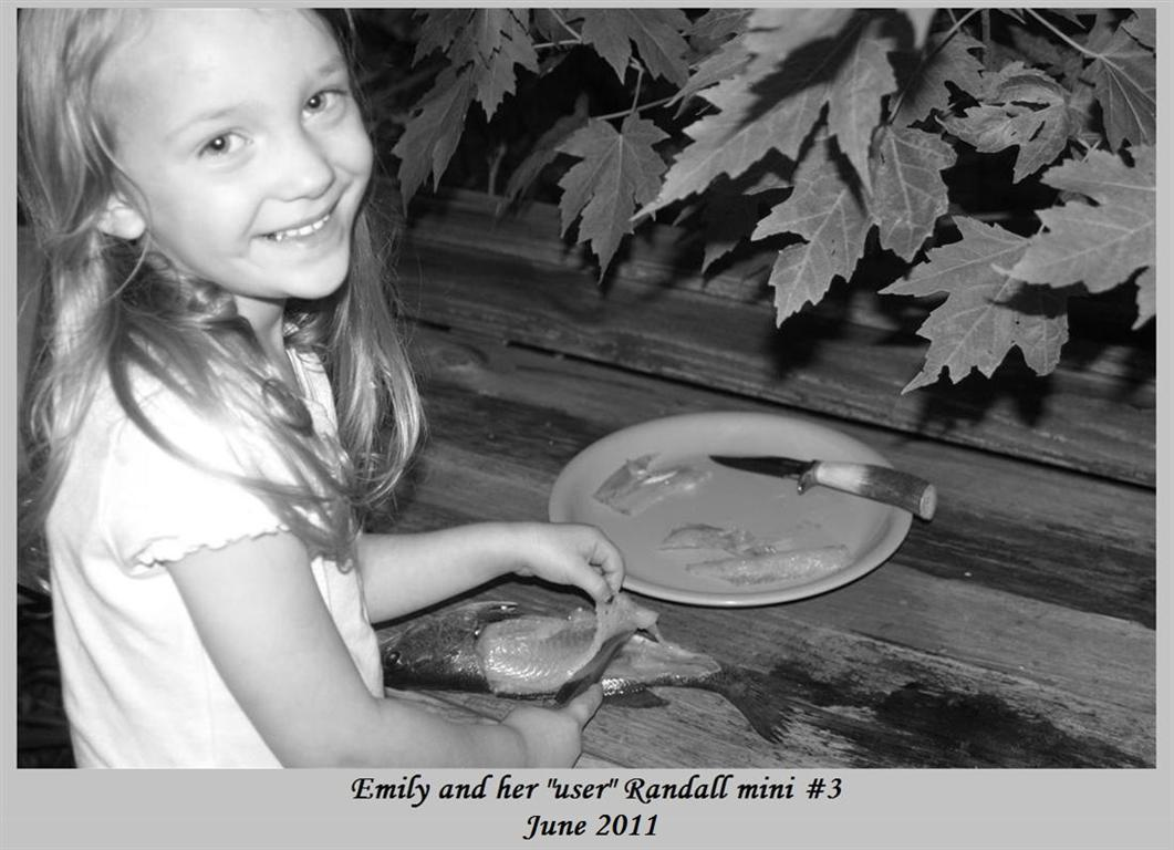 emily_cleaning_fish_2011_BW_bord_text_Med_.jpg